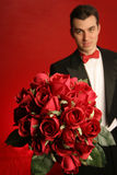 Man with roses Royalty Free Stock Photo