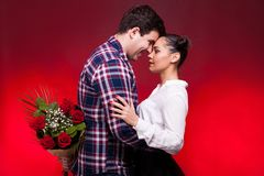 Man with a roses bouquet at his back on a first date Royalty Free Stock Image