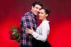 Man with a roses bouquet at his back on a first date Royalty Free Stock Photo