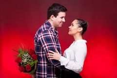 Man with a roses bouquet at his back on a first date Royalty Free Stock Images