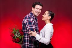 Man with a roses bouquet at his back on a first date Stock Photo