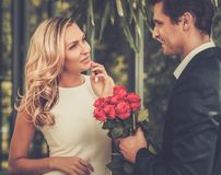 Man with roses dating his lady Royalty Free Stock Image