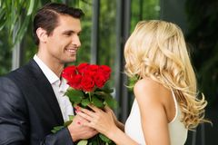 Man with roses dating his lady Royalty Free Stock Photo