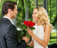 Man with roses dating his lady Royalty Free Stock Photography
