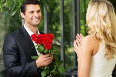 Man with roses dating his lady Stock Images