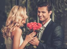 Man with roses dating his lady Royalty Free Stock Photos