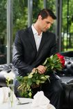 Man with roses in restaurant Royalty Free Stock Photography