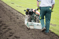 Man with rototiller Stock Photography