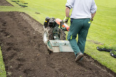 Man rototilling the ground Royalty Free Stock Images