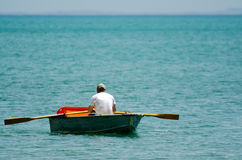 Man row dinghy Stock Photo