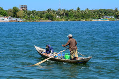 A man rowing boat on blue lake in Nhatrang Royalty Free Stock Images