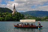 A Man Rowing a Boat on Lake Bled Royalty Free Stock Photo