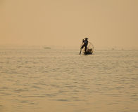 A man rowing boat on lake in Inle, Myanmar Royalty Free Stock Image