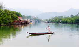 A man rowing boat at the village in Koh Chang, Thailand Royalty Free Stock Photography