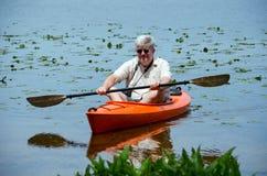 Man rowing a kayak Royalty Free Stock Photos