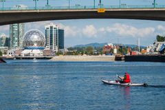 Man rowing a kayak in False Creek, Vancouver Royalty Free Stock Photography