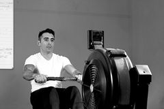 Man on rowing machine - crossfit workout Stock Images