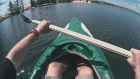 Man rowing with a paddle close-up stock footage