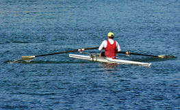 Man rowing a rowboat Royalty Free Stock Images