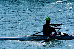 Man rowing a rowboat Royalty Free Stock Photography