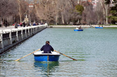 Man Rows a Dingy Stock Photo