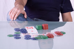 Man with Royal Flush on a Texas Hold'em Table Stock Image