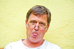 Man rshowing his tongue Royalty Free Stock Images