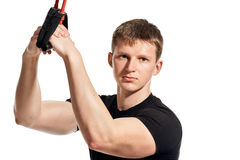 Man with rubber expander sport portrait Stock Image