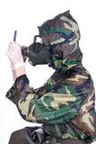 Man in a rubber gasmask. Man in a rubber hazmat holding a counter Royalty Free Stock Images