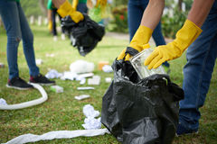 Man in rubber gloves collecting rubbish Royalty Free Stock Images