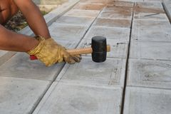Man with Rubber Mallet Paving Stock Photography