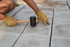 Man with Rubber Mallet Paving Stock Images