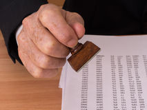 Man with rubber stamp Stock Photography