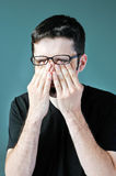 Man rubbing eyes Stock Image