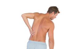 Man rubbing his back because of a back pain. On white background Royalty Free Stock Image