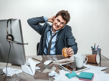 Man rubbing his neck with hand. At working place, sloth and laziness concept Royalty Free Stock Photography