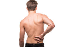 Man rubbing his painful back. Pain relief, chiropractic concept. Close up of man rubbing his painful back. Pain relief, chiropractic concept stock photo