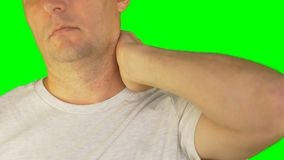 Man rubbing neck and shoulders with left hand. Extreme close up front view. Locked shot. stock video footage