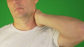 Man rubbing neck and shoulders with left hand. Extreme close up front view. Locked shot. stock video