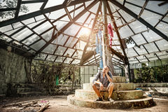 Man in ruined greenhouse Royalty Free Stock Photography