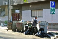 Man rummaging through garbage Royalty Free Stock Images