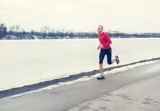 Man run near winter lake Stock Images