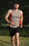 Man run in park. Caucasian man run in a park at susnet Stock Photo