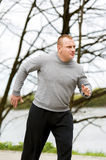 Man run by the river. Outdoor jogger. Stock Photo