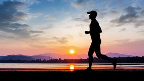Man run at seaside on evening Stock Photography