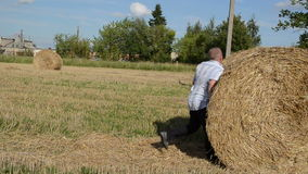 Man run strike crash fall down round straw bale stock video