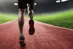 Man running on the track royalty free stock photo
