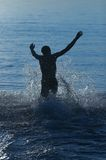 Man run in water Royalty Free Stock Photography