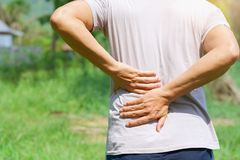 Man runing with back pain. At outdoor Royalty Free Stock Photography