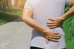 Man runing with back pain. At outdoor Royalty Free Stock Image